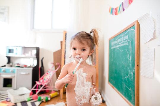 little girl paints on body