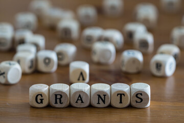 Grants written with wooden cubes