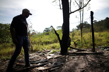 Police Chief Da Cunha shows a location used for torture and executions during a operation to search for bodies of men killed by a criminal faction in a clandestine cemetery in Sao Paulo