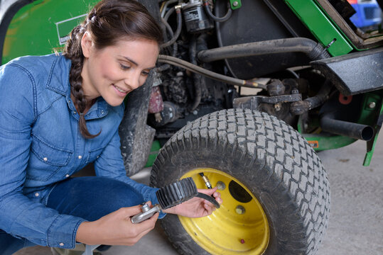 mechanics with farming industry giant tractors and plows