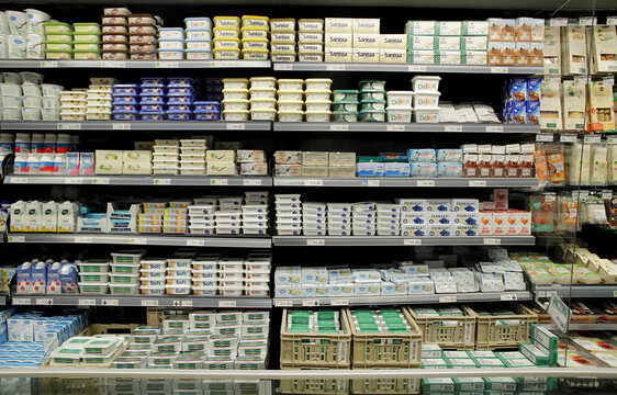 Various butter and margarine product are displayed on a refrigerated shelf at a supermarket of Swiss retail group Migros in Zurich