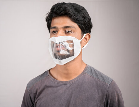 young man weared with transparent Medical face mask, to help hearing impairment or deaf people to understand lipreading during coronavirus or covid-19 outbreak.