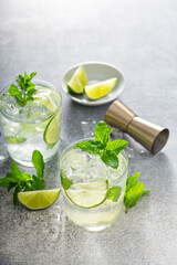 Refreshing summer mojito cocktail with lime and mint
