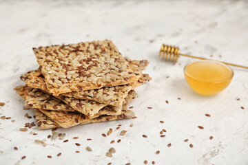 Cereal cookies and honey on white background