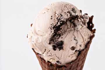 Cookies and cream ice cream in chocolate waffle cone