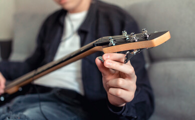 teenager tunes an electric guitar Wall mural