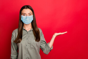 Close-up portrait of her she nice healthy girl wearing safety gauze mask holding on palm copy space mers cov flu contamination case world isolated bright vivid shine vibrant red color background