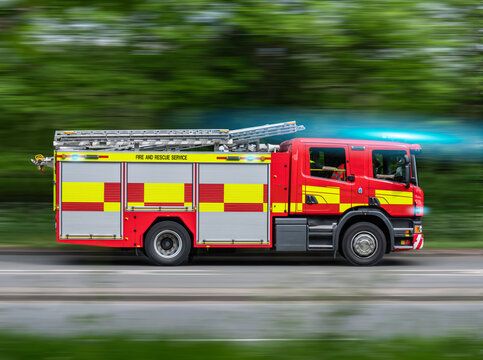 UK Fire Engine Responding To Emergency On Blue Lights