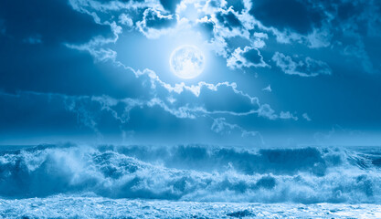 Wall Mural - Night sky with moon in the clouds on the foreground stormy sea wave