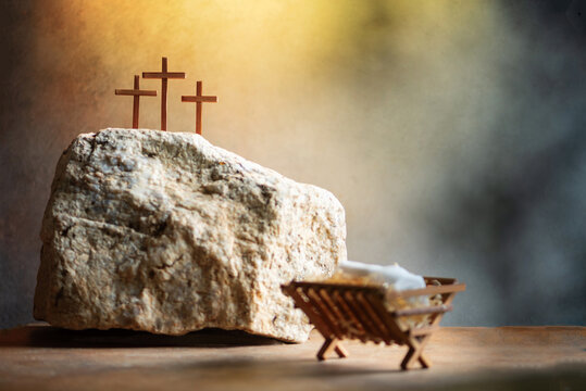 Christian Christmas, Easter concept. Born to Die, Born to Rise. Wooden manger, three crosses background. Jesus - reason for season. Salvation, Messiah, Emmanuel, God with us. Chronology of Jesus life