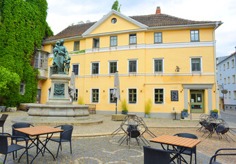 Weimar, Germany 05-19-2020 Dornenhof building and restaurant open air furniture in times of  social distancing