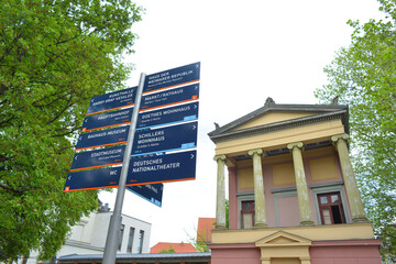 Weimar, Germany 05-19-2020 touristical indication and signs of tourist attractions in front of classical architecture