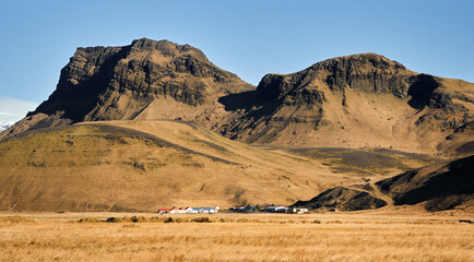 Iceland landscape with village houses mountain panorama beautiful islandic nature outdoor