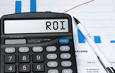 Word ROI on calculator. Business and tax concept. Stock photo