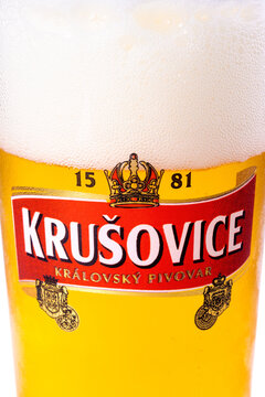 uzhgorod, ukraine - SEP 02, 2015: czech light beer. logo of a popular krusovice brand on a glass. white background