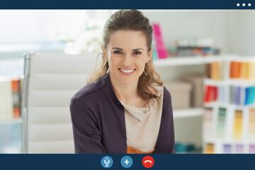 Fototapeta Video call screen of happy fashion designer in office obraz