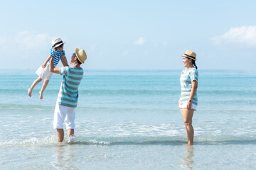 Happy family summer sea beach vacation. Asia young people lifestyle travel enjoy fun and relax leisure destination in holiday.