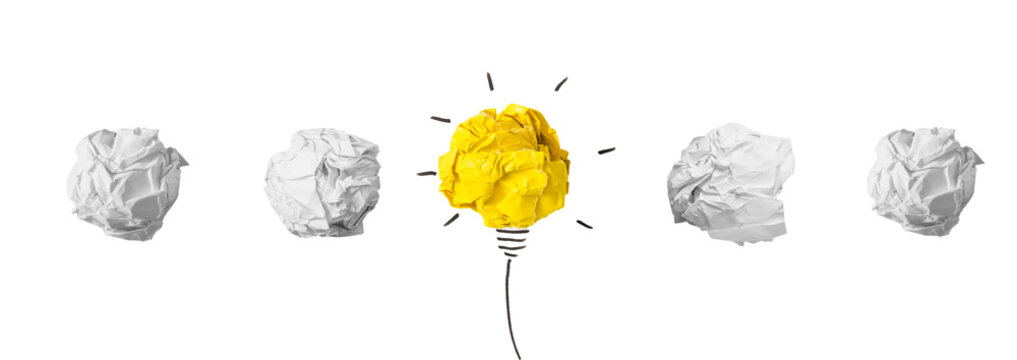 Creativity inspiration, ideas concepts with lightbulb from paper crumpled ball