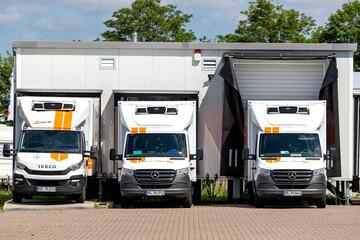 ROGGENTIN, GERMANY - JUNE 14, 2020: trans-o-flex delivery vans docked at warehouse.