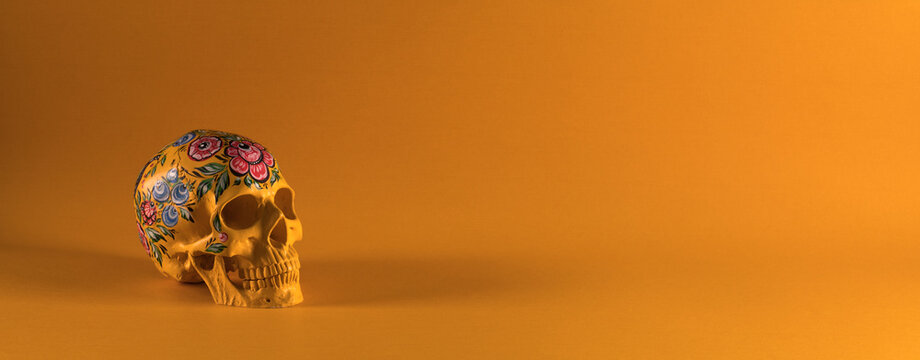 Day of the Dead, mexican skull isolated on orange background