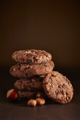 Stack of cookies with nuts on table