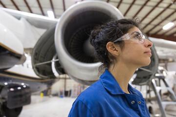 Maintenance engineer standing in hangar