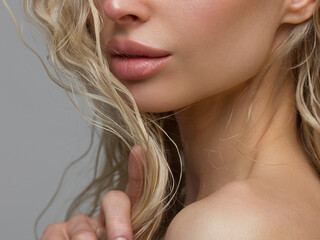 Obraz Close-up of woman's Lips with Fashion pink Make-up and Manicure on Nails. Beautiful female full lips with perfect Makeup. Part of female face. Macro shot of beautiful make up on full lips - fototapety do salonu