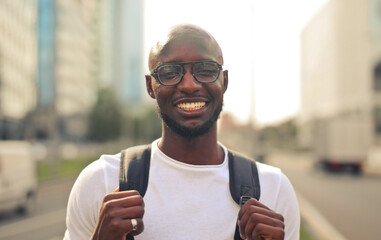 portrait of young smiling man on the street