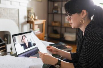 Teacher reading work during online tutorial