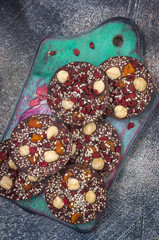 Homemade chocolate with hazelnuts barberry and dried apricots