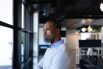 African American man looking outside