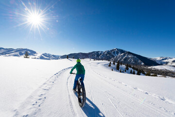 A woman riding her fat bike on a beautiful winter day in Sun Valley.