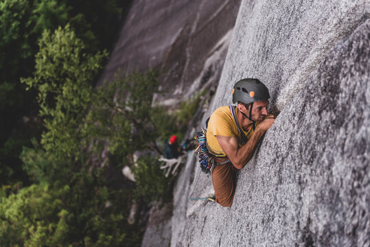 man trad rock climbing lead on granite wide crack Squamish Canada