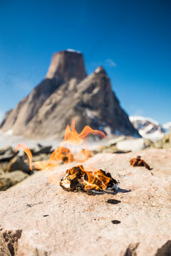 Flaming pile of toilet paper in remote mountains, leave no trace.