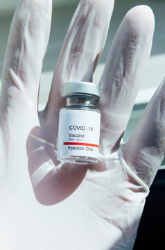 Doctor's hand showing Covid-19 vaccine, New York