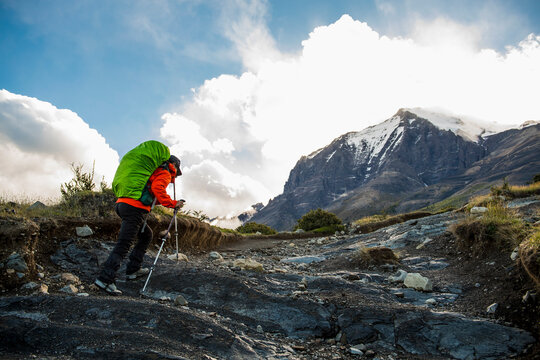 Female hiker on the way up to Torres del Paine National Park Patagonia