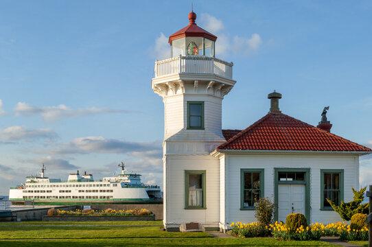 Victorian-style Mukilteo Lighthouse and docked ferry on Pacific Northwest coast, Washington state, USA