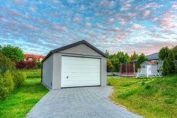 Free standing garage in the garden at sunset