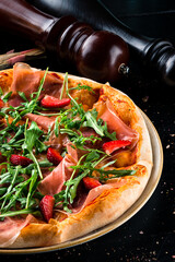 italian pizza with parma and strawberries
