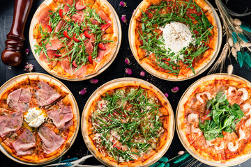 different pizzas on the set table