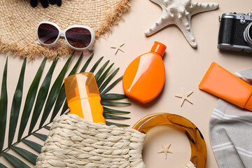 Flat lay composition with sun protection products and beach accessories on beige background