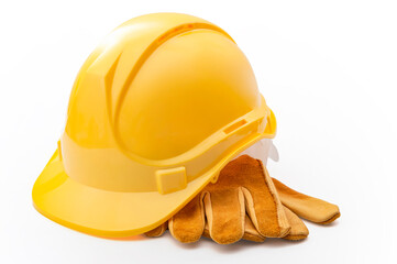 Middle class employment, labor day and industrial blue collar work concept with close up on a yellow hard hat and safety gloves isolated on white background with clipping path cutout