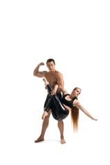 Young couple doing acrobatics isolated shot