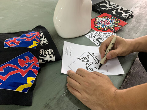 Malaysian textile and fashion designer Mohd Hafiz Drahman sketches a mask design based on traditional patterns at a studio, amid the coronavirus disease (COVID-19) outbreak in Shah Alam