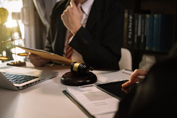 business people and lawyers discussing contract papers sitting at the table. Concepts of law,...