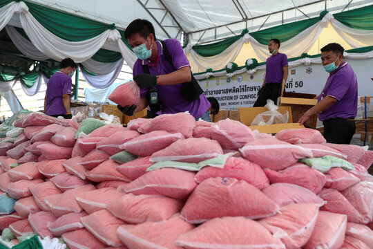Thai narcotics officials arrange bags of methamphetamine pills during the 50th Destruction of Confiscated Narcotics ceremony in Ayutthaya province