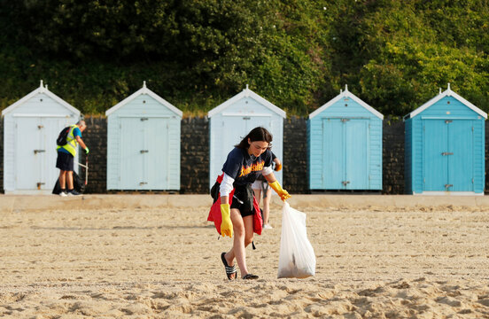 People pick up litter left on Bournemouth beach, as the outbreak of the the coronavirus disease (COVID-19) continues in Bournemouth