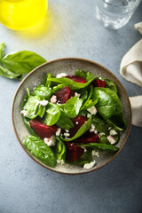Healthy spinach salad with beetroot and cheese