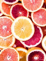 Wall Murals Slices of fruit Fresh and organic grapefruit slices.Close-up. Studio photography.