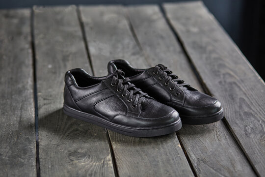 black shoes on a wooden